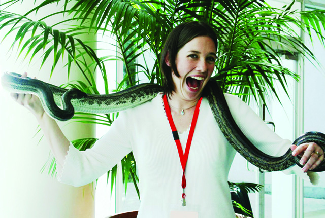 excited lady holds python