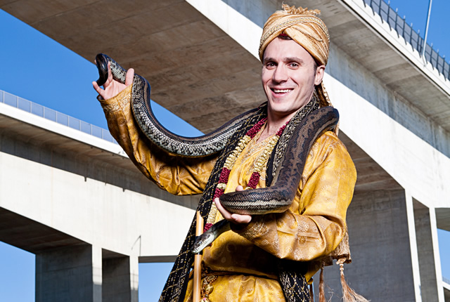 Johnny the Jester dressed as a snake charmer with python